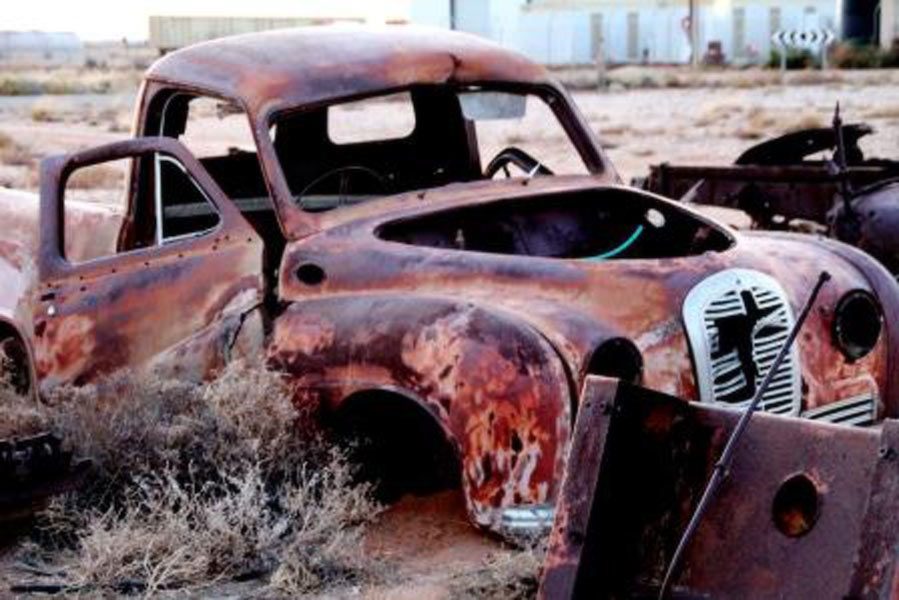 Photograph of rusted car