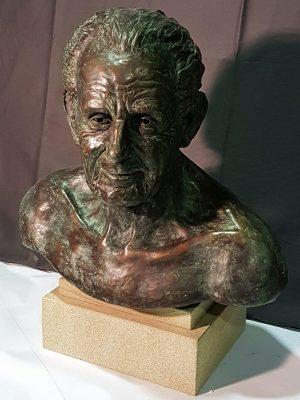 Bronze bust sculpture of male face